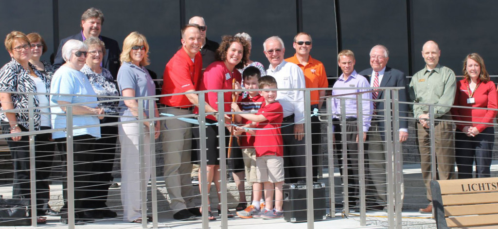 Ron and Hope along with their boys Ryland, left and Gavin cut the ribbon on the new facility on opening day in 2014.