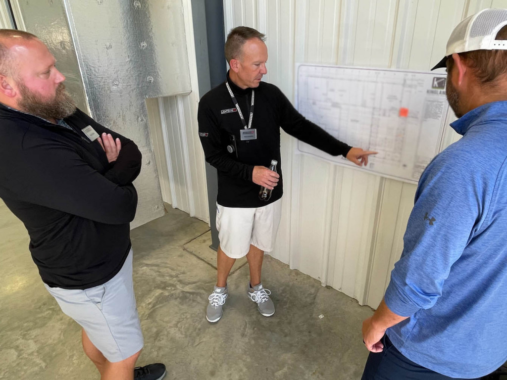 Ron Lichtsinn, center, explains expansion plans to Sales Consultants Cody Lycke, left, and Reed  Burkholder on Wednesday, Sept. 8, 2021.
